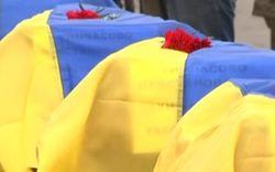В Запорожье и Днепропетровске хоронят десятки неопознанных бойцов АТО