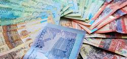 Курс тенге на Форекс падает  к юаню, рублю и евро