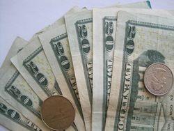 Курс доллара США падает к мировым валютам на рынке форекс на фоне сокращения прибыли ФРС