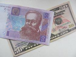 Курс гривны упал к доллару США еще на 0.91%