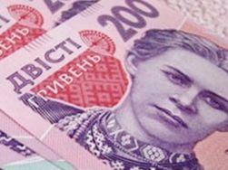 Курс гривны в 2014 году снизится еще на 11 процентов – Standard & Poor's