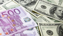 Евро вырос к курсу доллара на 0,14% на Форекс на фоне смягчения отношения Путина к Украине