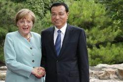 Меркель договаривается с Китаем о влиянии на РФ
