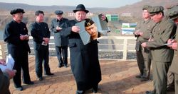 Ким Чен Ын с портретом Путина