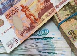 Рубль укрепили Китай и валютные долги