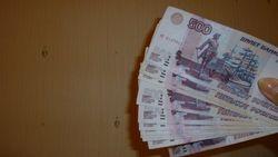 Курс рубля укрепился к гривне на 1% и упал к доллару США на 0.22%