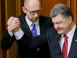 Яценюк заявил, что Кабмин остается работать единой командой