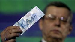 Банкоматы не признают новую олимпийскую купюру 100 рублей