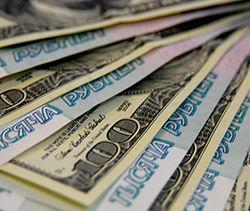 Средневзвешенный курс доллара опустился до 35,51 рубля на форексе