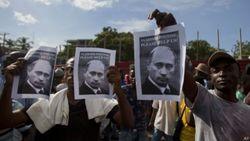 Демонстранты Гаити просят помощи у Владимира Путина