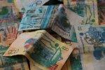 Курс тенге укрепляется к швейцарскому франку и японской иене