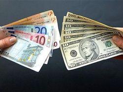 Курс евро понизился к доллару на Forex до 1.2918