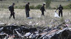 Эксперты приостановили работу на месте крушения Boing 777 из-за обстрела боевиками