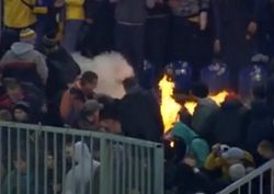 Фанаты «Металлиста» спалили гостевой сектор на «Днепр Арене»