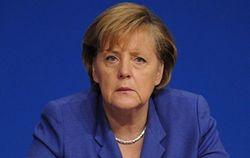 Меркель призывает Украину ограничить власть олигархов