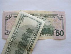 Курс доллара США растёт к мировым валютам на фоне снижения доходности по трежерис