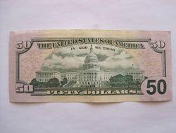 Курс доллара США снизился к мировым валютам на фоне данных с рынка труда и жилья
