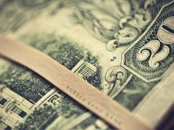 Курс доллара укрепился к фунту на 0,07% на Форекс на фоне ожиданий отчетов Великобритании