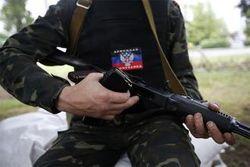 Зона АТО: боевики бомбят поселок Коммунар – горят дома