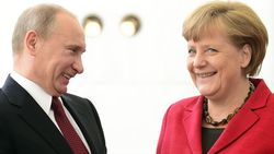 Путин обсудил гуманитарную помощь Украине с Ангелой Меркель