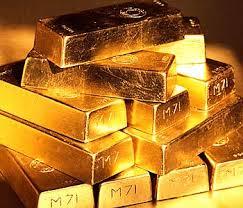 Золото третью сессию подряд дешевеет на новостях от ФРС