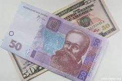 На фоне кредитного договора  в Украине дешевеет доллар