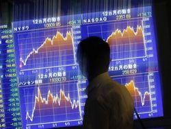 Под давлением решения ФРС азиатские рынки акций торгуются в плюсе