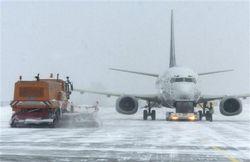 Первые убытки Москвы из-за снега - отмена авиарейсов