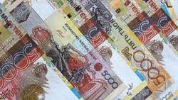 Курс тенге снизился к австралийскому доллару, но укрепился к фунту стерлингов