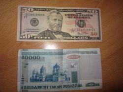 Курс белорусского рубля снизился к канадскому доллару, но укрепился к фунту стерлингов и швейцарскому франку