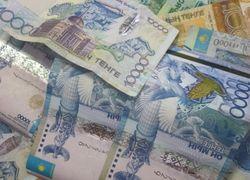 Курс тенге укрепился к швейцарскому франку, но снизился к канадскому доллару