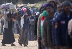 Ливийцы пытаются найти убежище в Тунисе