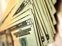 За счет чего укрепился курс доллара?