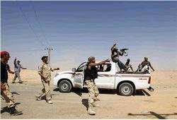 Сторонники Каддафи не сдаются силам НПС