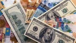 Курс тенге упал к доллару, российскому рублю и франку