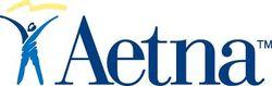 Квартальная прибыль Aetna Inc упала в два раза