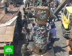 Памятник режима Каддафи в Триполи пустили на распил