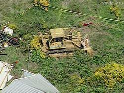 Нравы США: мужчина бульдозером разрушил 4 дома надоедливых соседей