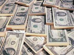 Курс доллара начал укрепляться на торгах ММВБ