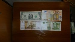 Курс российского рубля укрепился к евро и фунту, но снизился к японской иене