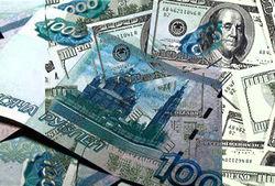 Рубль укрепился к доллару, несмотря на падение цен на нефть